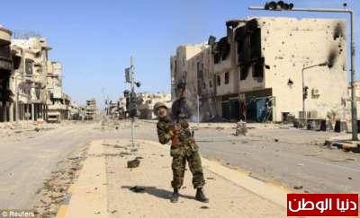 بالصور صحيفة ديلي البريطانية: أطلقَ النار القذافي 3909773568.jpg