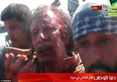 بالصور صحيفة ديلي البريطانية: أطلقَ النار القذافي 3909773578.jpg