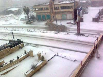 فلسطين تكتسي بالثوب الأبيض 3909792636.jpg