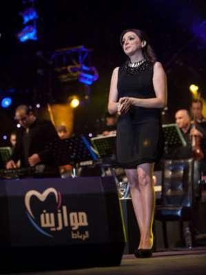 انغام ترتدي فستان قصير والجمهور يغادر الحفل ..صور