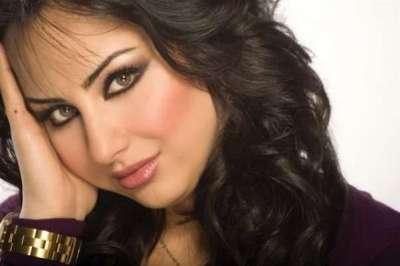 مذيعة قناة العربية: العراقية سهير القسي 3909823135.jpg
