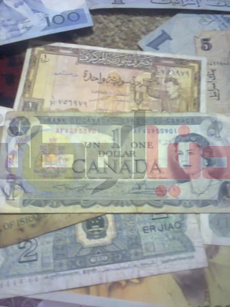 بالصور..غزّي يمتلك ورقة نقدية قديمة لكافة العالم:كل ورقة أطرفها 3909880822.jpg