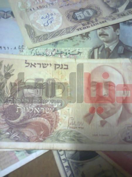 بالصور..غزّي يمتلك ورقة نقدية قديمة لكافة العالم:كل ورقة أطرفها 3909880830.jpg