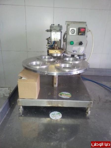 بالصور:صناعة الجبنة الايطالية بأيادي فلسطينية لتنافس الأجبان الاسرائيلية 3909897299.jpg