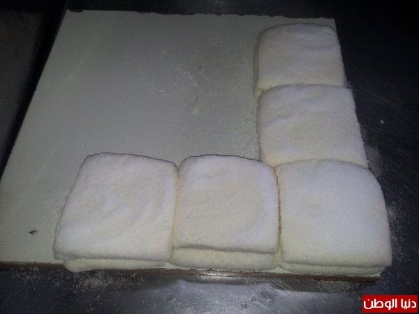 بالصور:صناعة الجبنة الايطالية بأيادي فلسطينية لتنافس الأجبان الاسرائيلية 3909897306.jpg