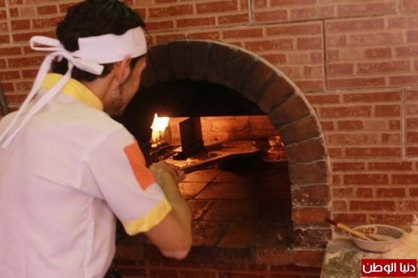 بغزة:لاجئون سوريون يفتحون مطاعم للماكولات 3909939627.jpg
