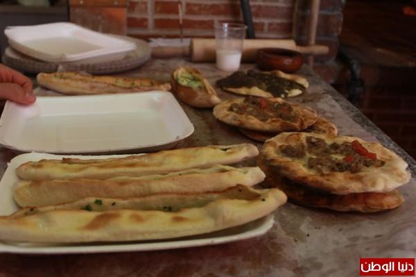 بغزة:لاجئون سوريون يفتحون مطاعم للماكولات 3909939630.jpg