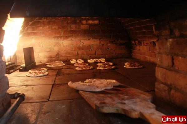بغزة:لاجئون سوريون يفتحون مطاعم للماكولات 3909939631.jpg