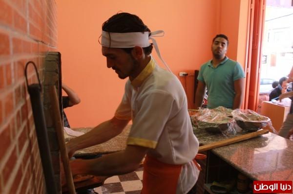 بغزة:لاجئون سوريون يفتحون مطاعم للماكولات 3909939632.jpg