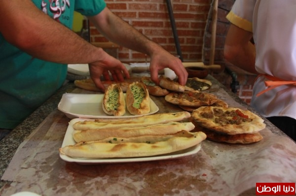 بغزة:لاجئون سوريون يفتحون مطاعم للماكولات 3909939634.jpg