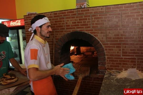 بغزة:لاجئون سوريون يفتحون مطاعم للماكولات 3909939637.jpg