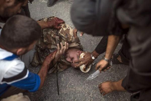 بالصور: جندي سوري أيدي عناصر 3909989380.jpg