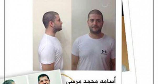 3910032633 صور اسامة محمد مرسي يتصور بالملابس البيضاء تضامنا مع والده