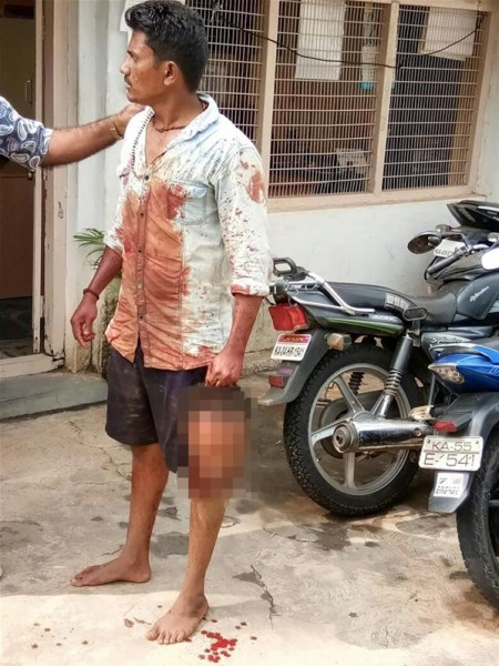 India: A man cuts his childhood friend's head and hands him to the police because of what he did to his mother