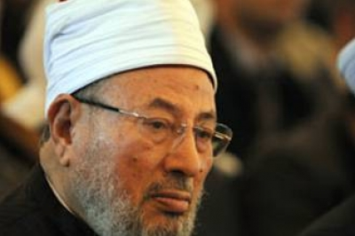 """القرضاوي:لو بعث محمد من جديد لوضع يده بيد """"الناتو"""" .. والهباش ينتقده"""