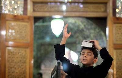 بالصور..الشيعة يحتفلون بليلة القدر