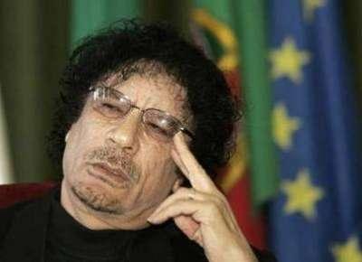 ظهور صورة القذافي في اجتماع الحكومة الليبية يثير ذعرا ً شديداً