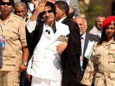 الأشعل: مساعدو القذافي سيحصلون الجنسية