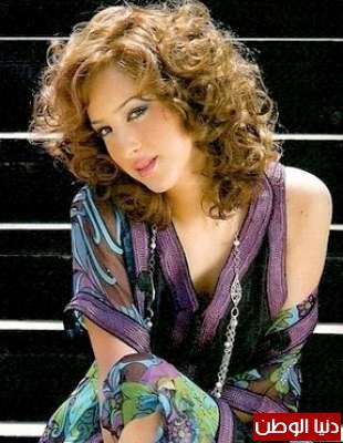 بالصور .. من هي زوجة تامر حسني
