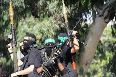 بالصور.. عرض عسكري مهيب للقسام بغزة في الذكرى الاولى لعملية تبادل الاسرى