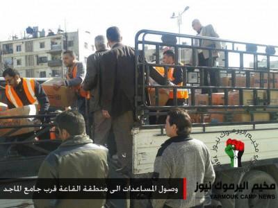 """بالفيديو: فك الحصار عن """"مخيم اليرموك"""" وقوافل بشرية تمكنت من الوصول للمحاصرين"""