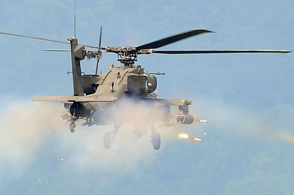 Apache Helicopter In Action Pictures to pin on Pinterest Army Helicopters In Action