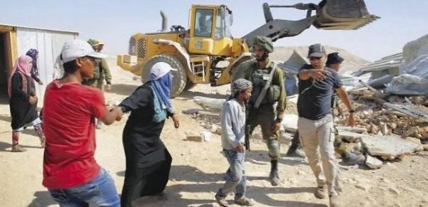 مستوطنون يجرفون أراضٍ لمواطنين جنوبي نابلس