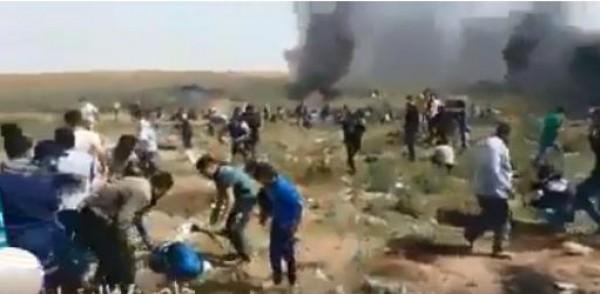 """شاهد: لحظة قنص جنود الاحتلال للصحفي """"أحمد أبو حسين"""""""
