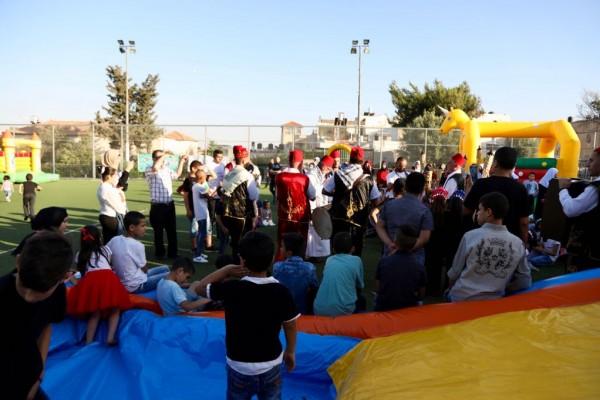 أطفال الداخل يشاطرون أيتام القدس في يوم احتفالي ترفيهي