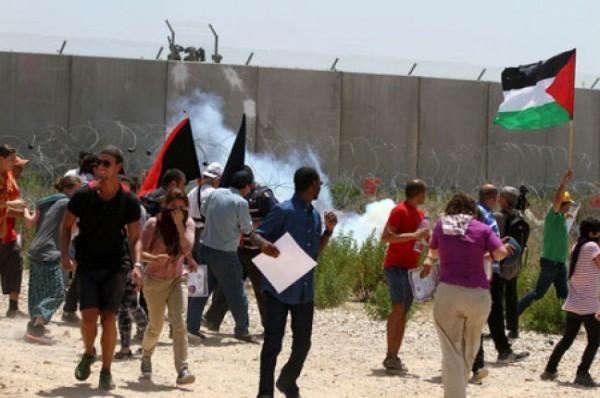 مسيرة بلعين تندد بقانون القومية الاسرائيلي العنصري