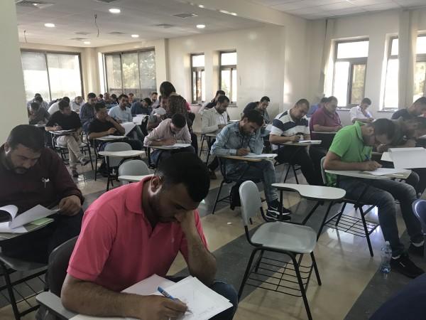 سلطة الاراضي تعقد امتحان مزاولة مهنة المساحة في الكلية العصرية الجامعية