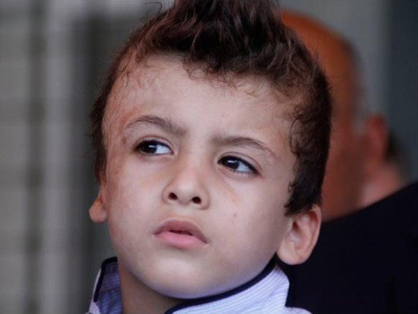 """شاهد كيف بدا """"أحمد الدوابشة"""" في يومه الأول في المدرسة"""