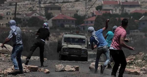 """إصابات بالرصاص """"المطاطي"""" والاختناق خلال قمع الاحتلال لمسيرة كفر قدوم"""