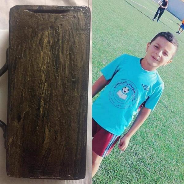 طفل طوباسي يتبرع بقيمة حصالته لنادي طوباس الرياضي