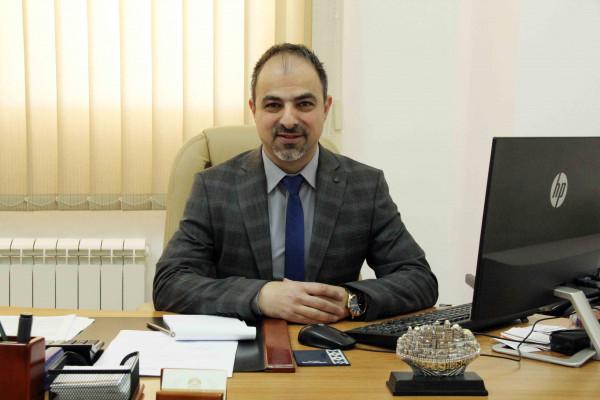 أبو غنام يتسلم مهام إدارة العلاقات الدولية والعامة في جامعة فلسطين الأهلية