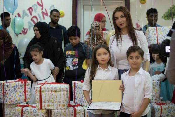 بيرقدار تغرس مباديء وقيم الانسانية في نفوس طفليها علي ونتالي