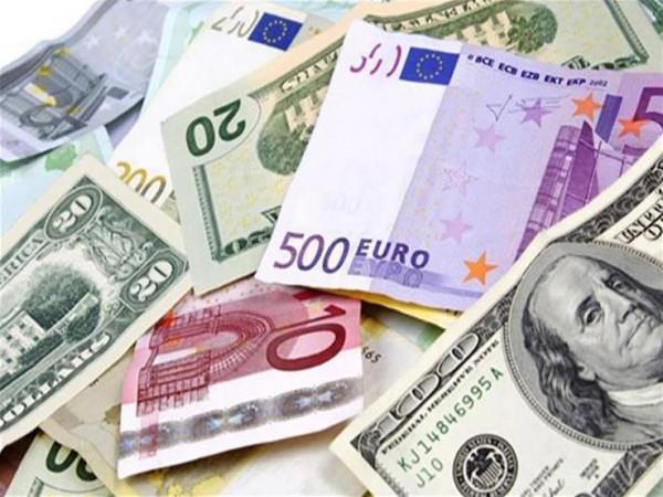 العملات: انخفاض طفيف على سعر صرف الدولار