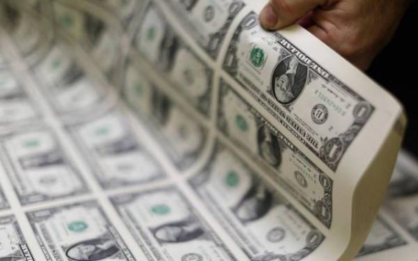 قيادي بحماس يوجه دعوةً للعالم بشأن التعامل بالدولار الأمريكي