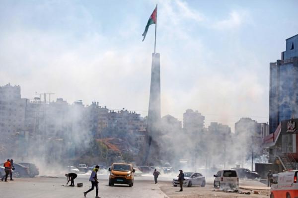 (محدث) الاحتلال يصيب 55 مواطنًا بينهم 4 أطفال ويعتقل 14 آخرين