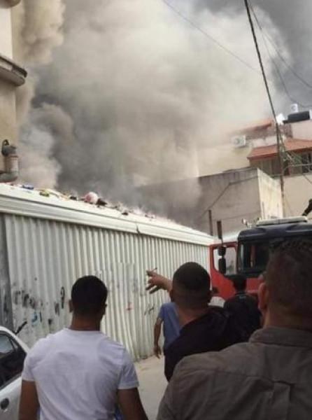 الهلال الأحمر: 13 حالة اختناق جراء اندلاع حريق في حي النقار بقلقيلية