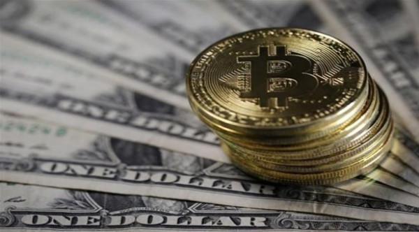 تراجع بيتكوين وريبل أمام الدولار