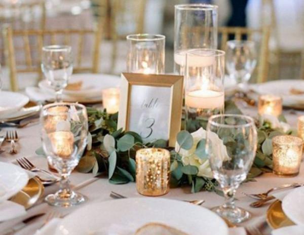 الشموع تمنحكِ حفل زفاف دافئ ورومانسي