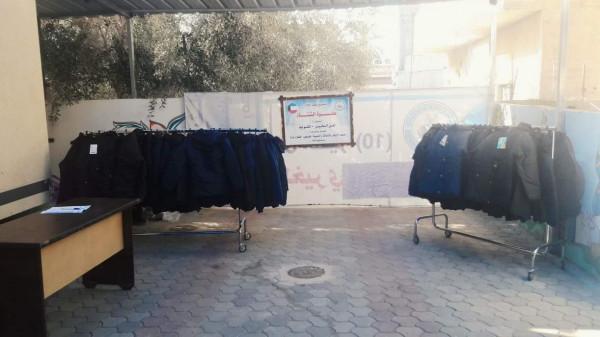 جمعية الإيثار توزع كسوة شتاء لـ 210 طلاب وطالبات بغزة