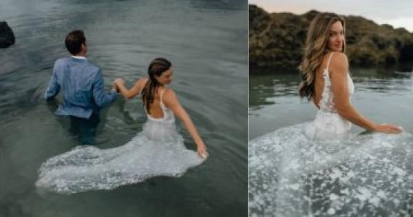 """""""عروسة البحر"""".. جلسة تصوير ساحرة لزوجين فى قلب الماء بملابس الزفاف"""