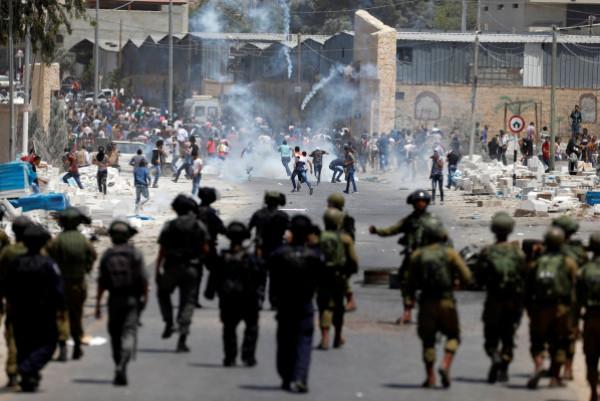 مواجهات مع الاحتلال واعتقال فلسطينيين من الضفة