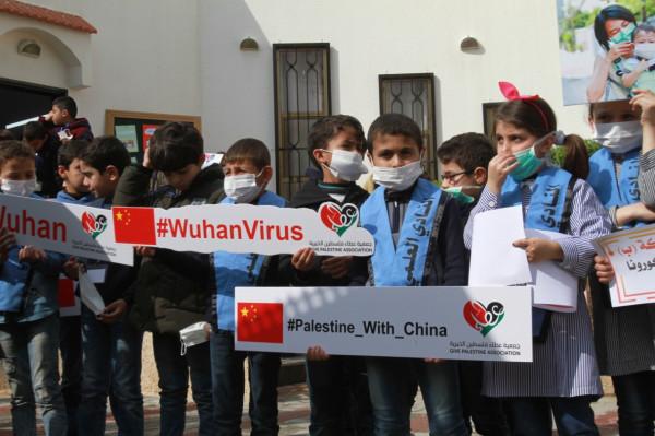 أطفال غزة يتضامنون مع الشعب الصيني في مواجهة فايروس كورونا
