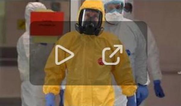 شاهد: بوتين يزور مصابي فيروس (كورونا) بلباس خاص
