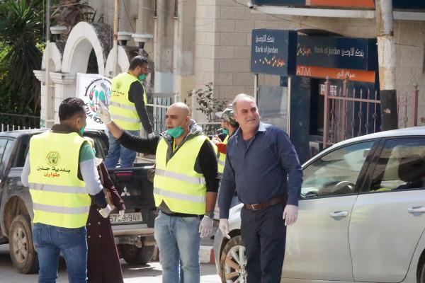 بلدية جنين تنفذ سلسلة إجراءات وقائية لتعقيم المدينة يومياً