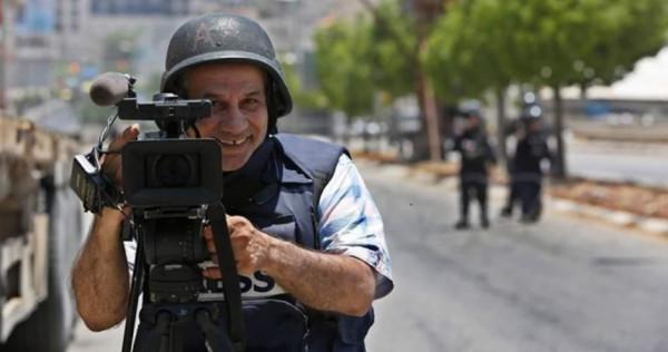 وقفة تضامنية في غزة مع مصور وكالة الـ AP الأمريكية إياد حمد