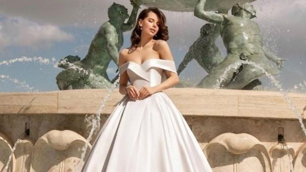 فساتين أفراح بصيحة الكتف المنسدل لإطلاله عصرية بحفل زفافك
